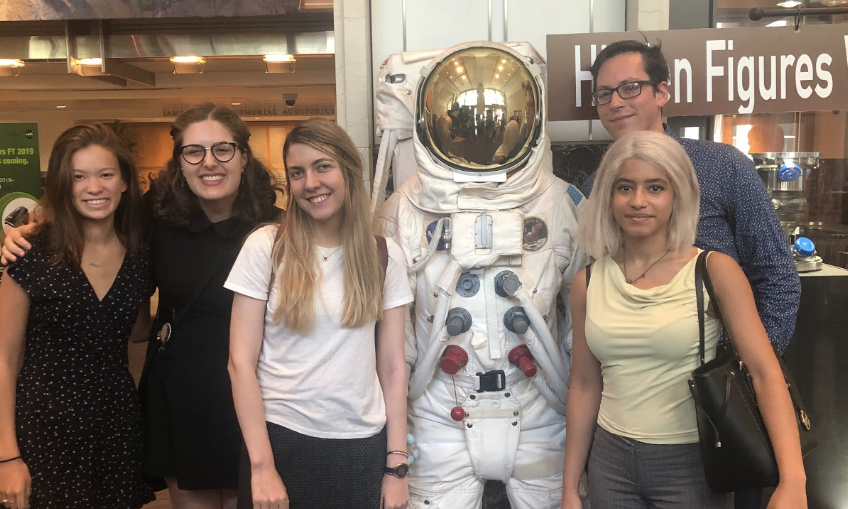 Students posing with NASA Space suit