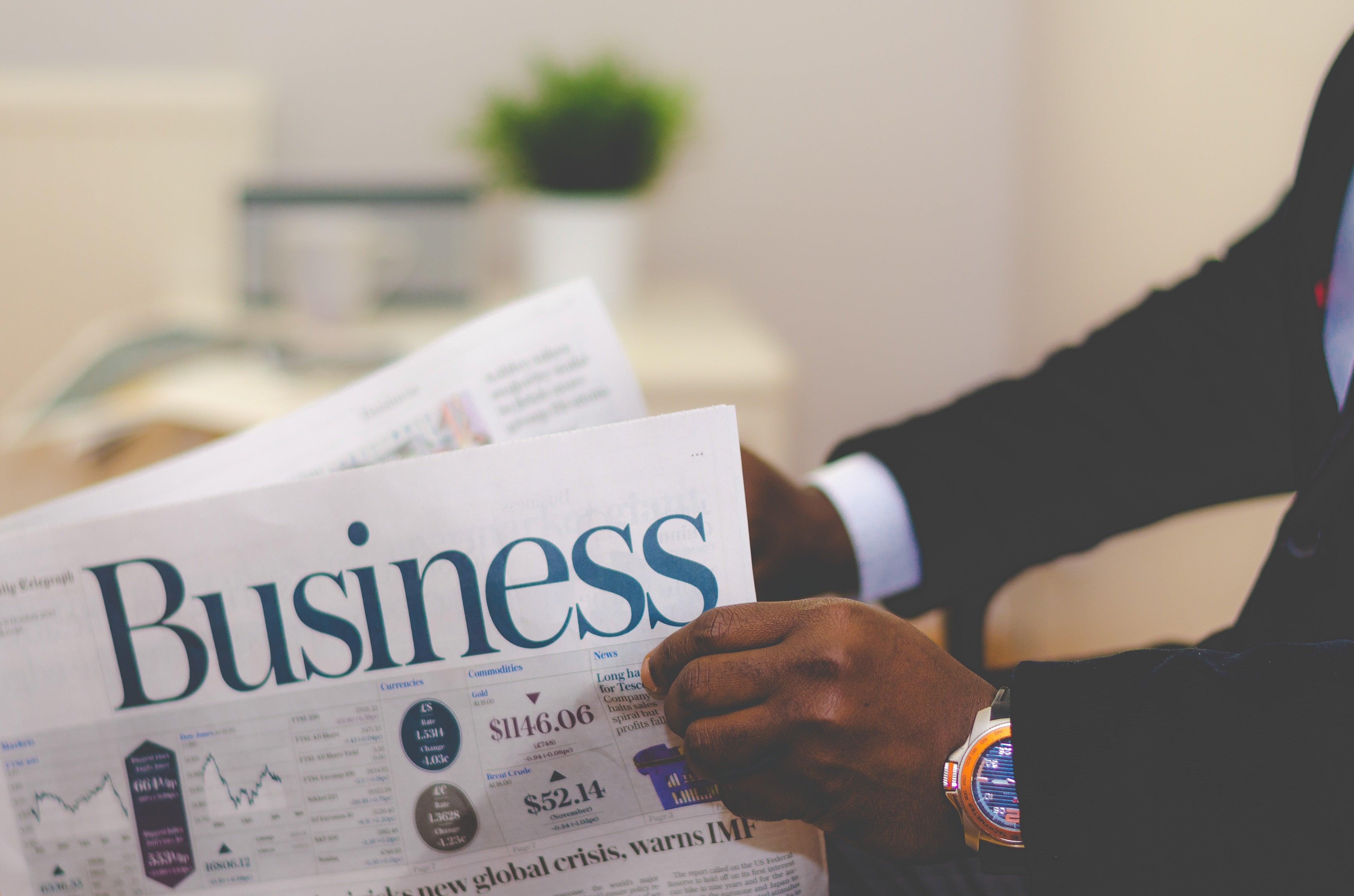 man reading business newspaper