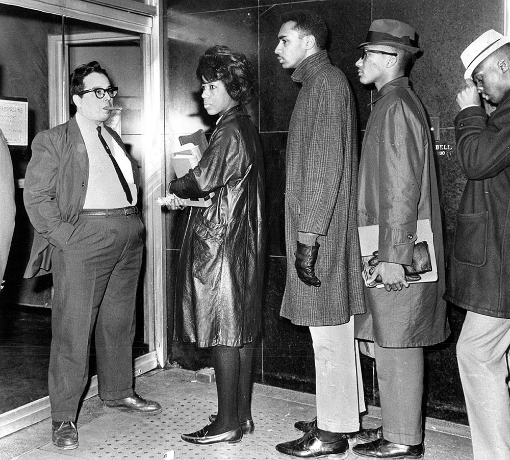African-Americans being refused entry to a theater in 1963
