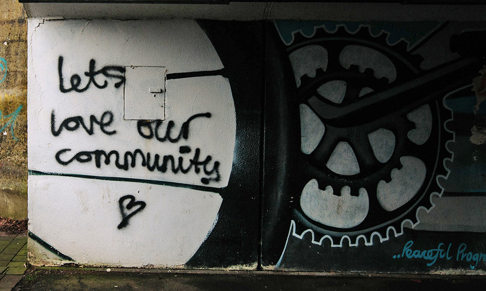 let's love our community painted on tunnel wall