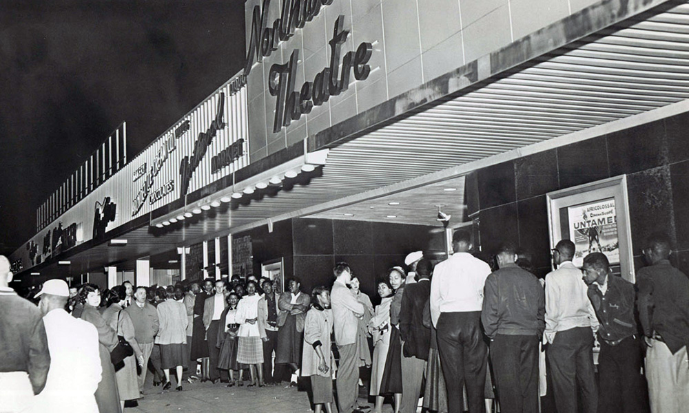 crowd in front of a movie theater, 1955
