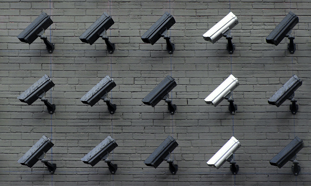 gray and white security cameras on a wall