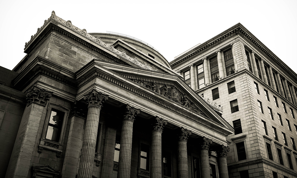 black and white image of a classical architecture bank building