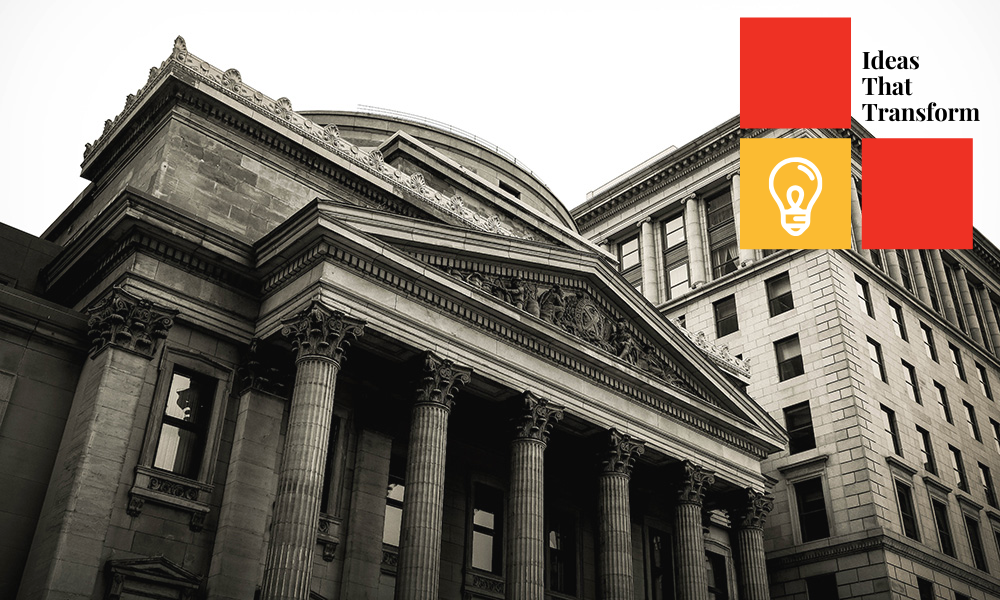 classical architecture bank with Ideas That Transform logo in upper right corner