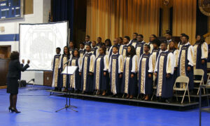 Stillman College choir in robes sing onstage