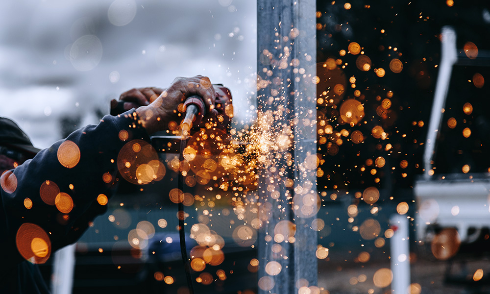 sparks fly in a closeup of a construction project