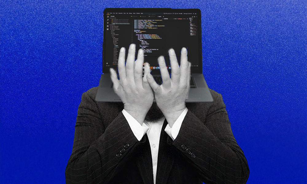 man in suit on blue background with laptop for head