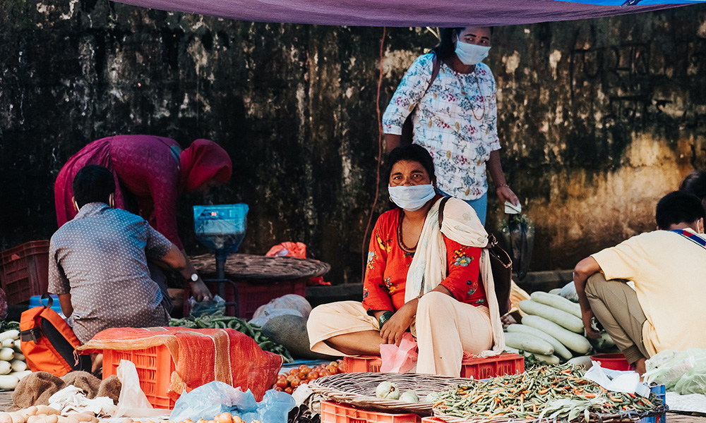 Women in Nepal selling vegetables in the market wearing a face mask, during the COVID 19 pandemic