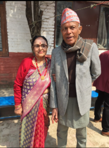 elderly man and woman stand side-by-side in Nepal