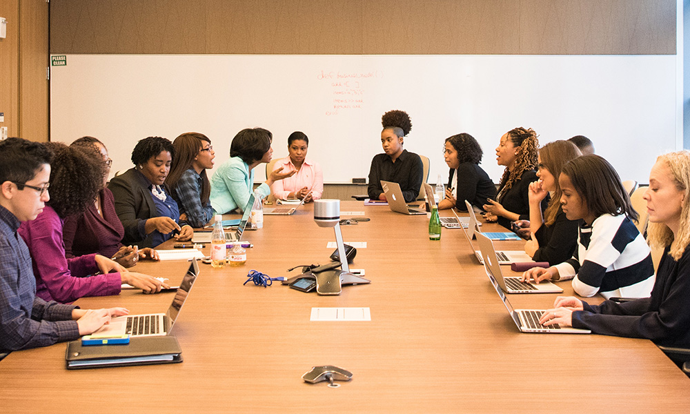 group of people sitting around a conference table